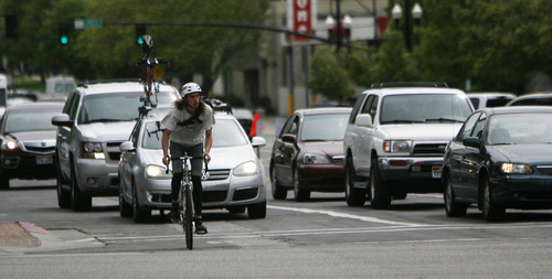 Francisco Kjolseth  |  The Salt Lake Tribune Bicyclists make their way through down town traffic on Monday, April 30, 2012. In 2012, Salt Lake City issued fewer citations to bicyclists than in the prior five years.