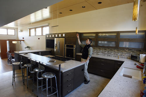 Rick Egan     The Salt Lake Tribune Energy efficient appliances in a home designed by Architect Dave Brach. The Salt Lake City house is only the second in Utah to be given the certification that it is totally green and energy efficient.