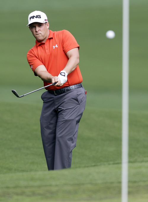 Daniel Summerhays watches his chip shot to the 15th green during the first round of the Wells Fargo Championship golf tournament at Quail Hollow Club in Charlotte, N.C., Thursday, May 2, 2013. (AP Photo/Bob Leverone)