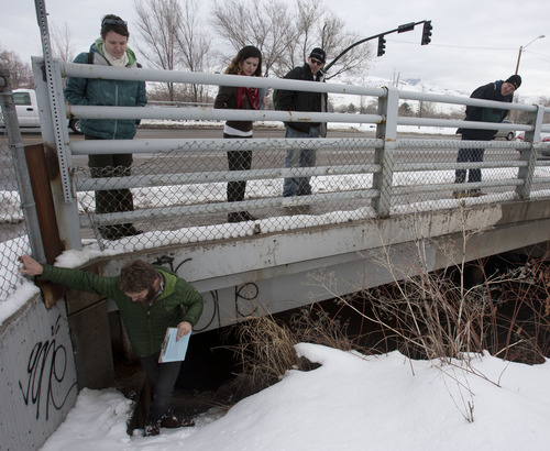 Steve Griffin | The Salt Lake Tribune   Road Home case manager, Buddy Tymczyszyn, crawls out from under an overpass that goes across the Jordan River near 600 north as his team members Suzie Whisenant, Stephanie Caya, Josh Holdaway and Tim Keffer look on during the point-in-time homeless people count in Salt Lake City, Utah Thursday January 31, 2013. Each year, during the count homeless people in Utah, are asked where they spent the night of January 30. The survey is conducted mainly between 4 a.m. and 7 a.m. by teams of volunteers who go to shelters and areas where they know there are homeless people camping out. The results of the count and survey help address the needs of the homeless population in Utah.