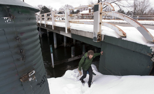 Steve Griffin | The Salt Lake Tribune   Road Home case manager, Buddy Tymczyszyn, walks out from under an overpass that goes across the Jordan River near 600 north during the point-in-time homeless people count in Salt Lake City, Utah Thursday January 31, 2013. Each year, during the count homeless people in Utah, are asked where they spent the night of January 30. The survey is conducted mainly between 4 a.m. and 7 a.m. by teams of volunteers who go to shelters and areas where they know there are homeless people camping out. The results of the count and survey help address the needs of the homeless population in Utah.