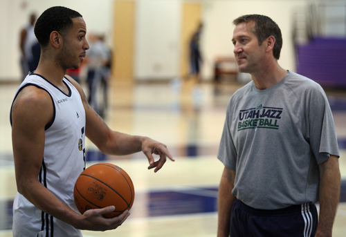 Lennie Mahler  |  The Salt Lake Tribune Devin Harris speaks with Jeff Hornacek during a practice at the Zions Bank Basketball Center on Sunday, May 6, 2012.