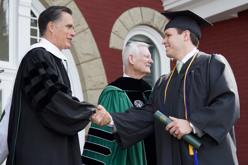 "Courtesy Southern Virginia University Mitt Romney shakes hands with a graduating student at Southern Virginia University on Saturday in Buena Vista, Va., where he urged graduates to ""launch into the deep"" and get out of their comfort zone."