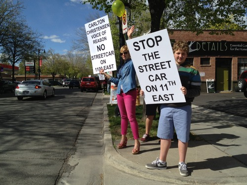 Trent Nelson  |  The Salt Lake Tribune Protesters rallied Wednesday against a proposal to extend the Sugar House Streetcar line north on 1100 East from 2100 South. The Salt Lake City Council is scheduled to vote on the proposal Tuesday.
