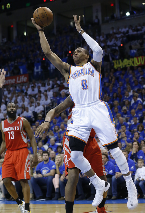 Oklahoma City Thunder guard Russell Westbrook (0) shoots against the Houston Rockets in the third quarter of Game 2 of their first-round NBA basketball playoff series in Oklahoma City, Wednesday, April 24, 2013. Oklahoma City won 105-102. (AP Photo/Sue Ogrocki)