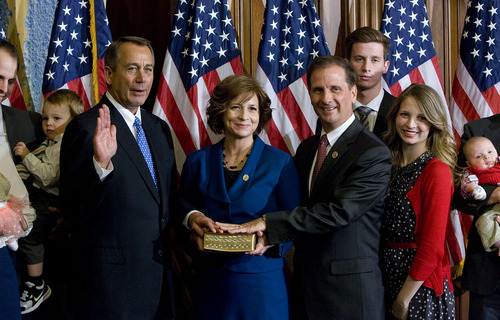 Scott Sommerdorf   |  The Salt Lake Tribune Congressman Chris Stewart, R-Utah poses during the ceremonial swearing-in photo opportunity with Speaker of the house John Boehner R-Ohio, and his wife Evie, and part of his family, Thursday, January 3, 2013.