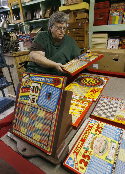 Francisco Kjolseth  |  The Salt Lake Tribune Clark Phelps, a long-time Midvale businessman who owns what is probably the world's largest collection of punchboards displays some of his graphically interesting and colorful games of chance that were outlawed in 1979. The boards made of cardboard Some have pennies, drawings, lighters, decks of cards, etc., as part of the display. People would buy a chance, punch out a ticket and hope to win at bars, coffee shops, even the Hotel Utah. He has between 8,000 and 10,000 of these boards, most in absolute mint condition.