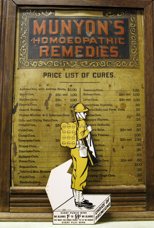 Francisco Kjolseth  |  The Salt Lake Tribune A World War I soldier known as a dough boy is features one of the more simple designs of a punchboard, featured next to an original homoeopathic remedies cabinet that claimed to fix many ailments for $2 or less. Clark Phelps a long-time Midvale businessman who owns what is probably the world's largest collection of punchboards displays the graphically interesting and colorful games of chance that were outlawed in 1979. With a small key you would push through the small hole that would punch out a piece of paper revealing your prize. Some have pennies, drawings, lighters, decks of cards, etc., as part of the display. People would buy a chance, punch out the ticket and hope to win at bars, coffee shops, even the Hotel Utah.