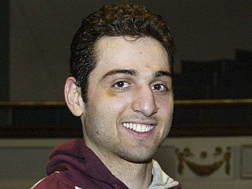 FILE - In this Feb. 17, 2010, photo, Tamerlan Tsarnaev, left, smiles after accepting the trophy for winning the 2010 New England Golden Gloves Championship in Lowell, Mass. Relatives of Tsarnaev, the older of the brothers suspected in the Boston Marathon bombing, will claim his body now that his wife has agreed to release it, an uncle said as officials in the U.S. and Russia deepened their investigations into him.  (AP Photo/The Lowell Sun, Julia Malakie, File) MANDATORY CREDIT