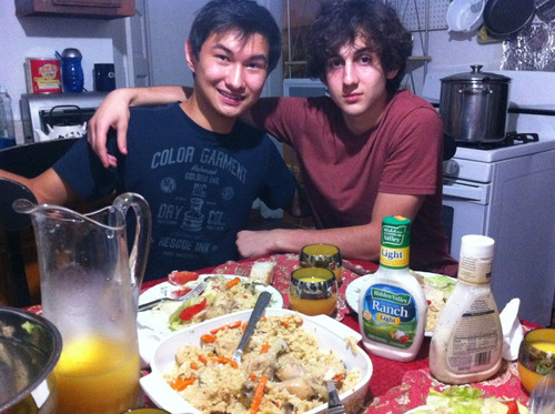 This undated photo found on the VK page of Dias Kadyrbayev shows Kadyrbayev, left, with Boston Marathon bombing suspect Dzhokhar Tsarnaev, at an unknown location. Kadyrbayev and Azamat Tazhayakov, two college buddies of Tsarnaev from Kazakhstan, were jailed by immigration authorities the day after his Tsarnaev's capture.  (AP Photo/VK)