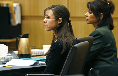 Defendant Jodi Arias, center, listens to defense attorney Kirk Nurmi make his closing arguments during her trial on Friday, May 3, 2013 at Maricopa County Superior Court in Phoenix.  Arias is charged with first-degree murder in the stabbing and shooting death of Travis Alexander, 30, in his suburban Phoenix home in June 2008. (AP Photo/The Arizona Republic, Rob Schumacher, Pool)