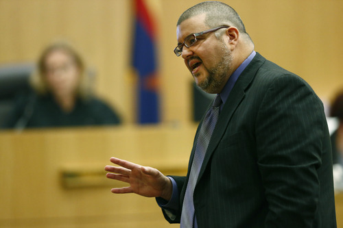 Defense attorney Kirk Nurmi makes his closing arguments during Jodi Arias murder trial on Friday, May 3, 2013 at Maricopa County Superior Court in Phoenix.  Arias is charged with first-degree murder in the stabbing and shooting death of Travis Alexander, 30, in his suburban Phoenix home in June 2008. (AP Photo/The Arizona Republic, Rob Schumacher, Pool)