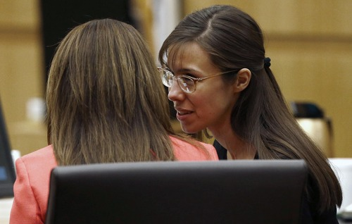 Defense attorney Jennifer Wilmott listens to defendant Jodi Arias, right, as lead defense attorney Kirk Nurmi make his closing arguments  during her trial Friday, May 3, 2013 at Maricopa County Superior Court in Phoenix.  Arias is charged with first-degree murder in the stabbing and shooting death of Travis Alexander, 30, in his suburban Phoenix home in June 2008. (AP Photo/The Arizona Republic, Rob Schumacher, Pool)