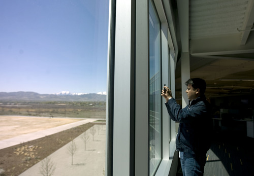 Kim Raff  |  The Salt Lake Tribune Shiv Agarwal a visiting eBay employee from California takes a picture of the mountain view that can be seen from all sides of eBay's new green certified building in Draper on May 2, 2013.