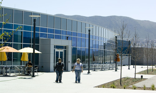 Kim Raff  |  The Salt Lake Tribune EBay employees walk on the outdoor patio space outside of eBay's new green certified building in Draper on May 2, 2013.