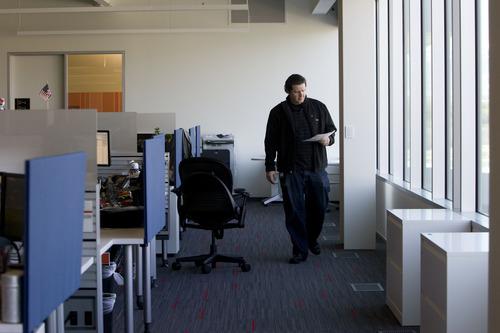 Kim Raff  |  The Salt Lake Tribune An employee walks in office space in eBay's new green certified building in Draper on May 2, 2013.