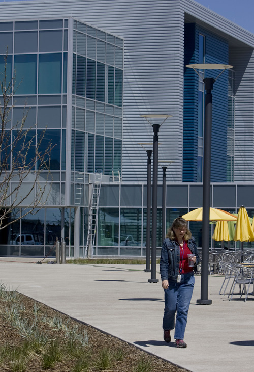 Kim Raff  |  The Salt Lake Tribune EBay employee Linda Corrigan walks on the outdoor lunch patio on the property of eBay's new green certified building in Draper on May 2, 2013.