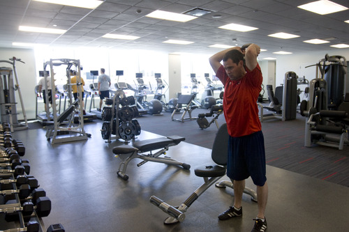 Kim Raff  |  The Salt Lake Tribune EBay employee Stephen Hall works out in the employee fitness center in eBay's new green certified building in Draper on May 2, 2013.