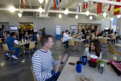 Kim Raff  |  The Salt Lake Tribune EBay employees (left) Michael Dent and Bronwyn Erasmus eat lunch in the employee cafeteria in eBay's new green certified building in Draper on May 2, 2013.
