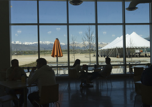 Kim Raff  |  The Salt Lake Tribune Employees sit in the cafeteria during their lunch break in eBay's new green certified building in Draper on May 2, 2013.