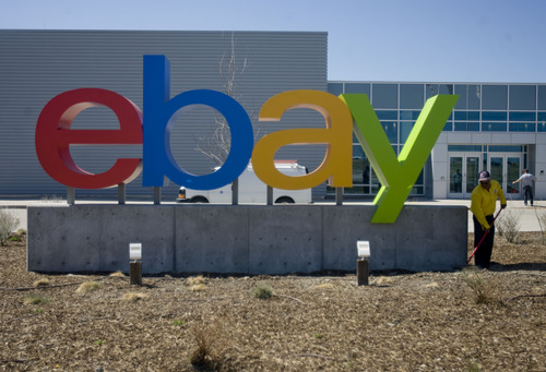 Kim Raff  |  The Salt Lake Tribune A landscaper works under the eBay sign at the front entrance of eBay's new green certified building in Draper on May 2, 2013.