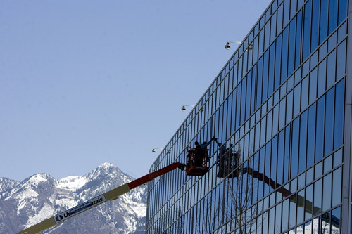 Kim Raff  |  The Salt Lake Tribune Window washers work on the side of eBay's new green certified building in Draper on May 2, 2013.