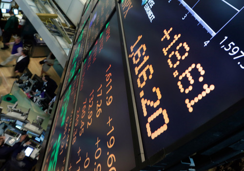A board overlooking the floor of the New York Stock Exchange shows an intraday number above 1,600 for the S&P 500, Friday, May 3, 2013. A big gain in the job market is lifting the stock market to a record high. The Dow Jones industrial average crossed 15,000 for the first time, and the Standard and Poor's 500 index, a broader market measure, rose above 1,600. (AP Photo/Richard Drew)