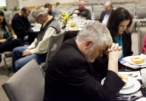 Kim Raff  |  The Salt Lake Tribune Mike Imperiale, pastor of First Presbyterian Church of Salt Lake City, bows his head in prayer Thursday during a worship service for the 62nd National Day of Prayer at Calvary Chapel of Salt Lake.