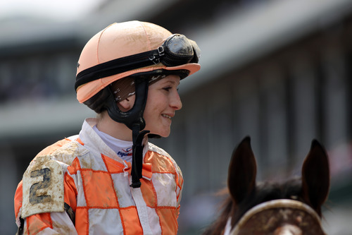 Jockey Rosie Napravnik is seen after winning a race at Churchill Downs Thursday, May 2, 2013, in Louisville, Ky. Saturday will be the 139th running of the Kentucky Derby. (AP Photo/Gregory Payan)