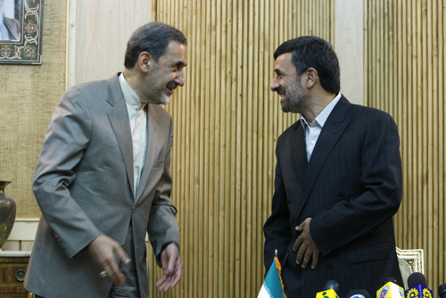 In this photo taken on Thursday, April 22, 2010, Iranian presidential hopeful, Ali Akbar Velayati, adviser to the Iranian supreme leader Ayatollah Ali Khamenei, left, talks with President Mahmoud Ahmadinejad, prior to departure of Ahmadinejad to Africa, at the Mehrabad airport, in Tehran, Iran. For eight years, Iran's President Mahmoud Ahmadinejad has played the role of global provocateur-in-chief: questioning the Holocaust, saying Israel should be erased from the map and painting U.N resolutions as worthless. Now, a race is beginning to choose his successor -- candidate registration starts Tuesday for a June 14 vote -- and it looks like an anti-Ahmadinejad referendum is shaping up. (AP Photo/Vahid Salemi)