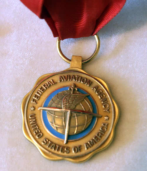 Photo courtesy of Betty Miller FAA Gold Medal presented by President John F. Kennedy to Betty Miller, the first woman to fly solo across the Pacific Ocean.