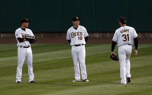 Steve Griffin | The Salt Lake Tribune  Bees outfielders Roberto Lopez, Trent Oeltjen and Brad Hawpe meet in centerfield during a pitching change in the Bees versus Sky Sox baseball game at Spring Mobile Ballpark in Salt Lake City, Utah Wednesday May 1, 2013.