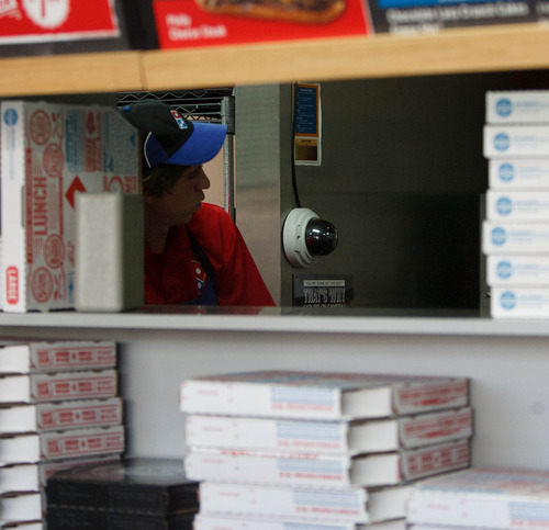 Trent Nelson  |  The Salt Lake Tribune A camera aims at a pizza oven at a Dominos Pizza location in Lehi Thursday, May 2, 2013. Dominos is streaming live video of the pizza-making process in the Lehi store.