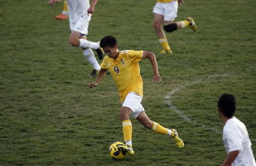 Chris Detrick  |  The Salt Lake Tribune Taylorsville's Edgar Estrade (9) during the game at Hunter High School Friday May 3, 2013.
