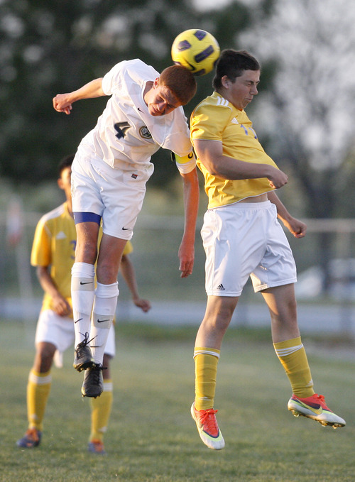Chris Detrick  |  The Salt Lake Tribune Hunter's Kendall Taylor (4) and Taylorsville's Keegan Fales (11) go for the ball during the game at Hunter High School Friday May 3, 2013.