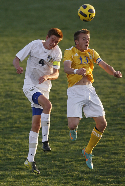 Chris Detrick  |  The Salt Lake Tribune Hunter's Kendall Taylor (4) and Taylorsville's Randy Ivins (13) go for the ball during the game at Hunter High School Friday May 3, 2013.