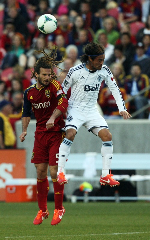 Kim Raff  |  The Salt Lake Tribune (left) Real Salt Lake midfielder Kyle Beckerman (5) and (right) Vancouver Whitecaps FC midfielder Daigo Kobayashi (14) compete for a head ball during a match at Rio Tinto Stadium in Sandy on May 4, 2013.  Real Salt Lake went on to win the game 2-0.