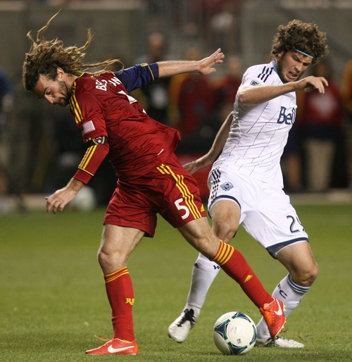 Kim Raff  |  The Salt Lake Tribune (left) Real Salt Lake midfielder Kyle Beckerman (5) and (right) Vancouver Whitecaps FC forward Tommy Heinemann (29) compete for a ball during a match at Rio Tinto Stadium in Sandy on May 4, 2013.  Real Salt Lake went on to win the game 2-0.
