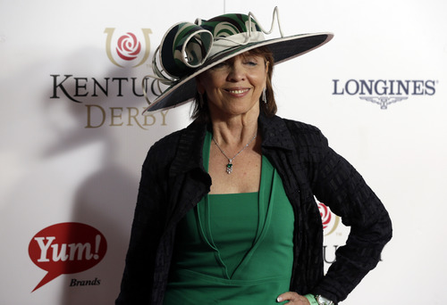 Author Nora Roberts arrives to attend the 139th Kentucky Derby at Churchill Downs Saturday, May 4, 2013, in Louisville, Ky. (AP Photo/Darron Cummings)