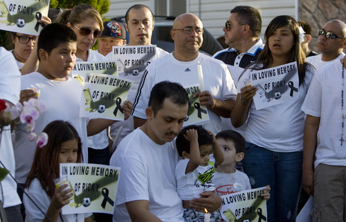 Kim Raff  |  The Salt Lake Tribune Friends and family of soccer referee Ricardo Portillo hold signs and candles during a news conference Sunday. Portillo died Saturday, a week after police say a player punched him in the head during a game.