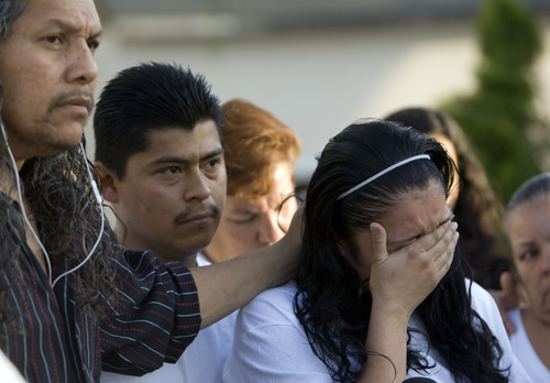 Kim Raff  |  The Salt Lake Tribune Johana Portillo-Lopez, daughter of volunteer soccer referee Ricardo Portillo, is comforted by Antonio Lopez, brother-in-law of Ricardo, as she speaks Sunday in Salt Lake City. Portillo died Saturday, a week after police say a player punched him in the head during a game.