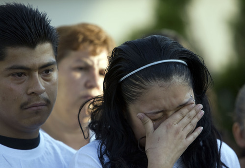 Kim Raff  |  The Salt Lake Tribune Johana Portillo-Lopez, daughter of volunteer soccer referee Ricardo Portillo, cries at a news conference in Salt Lake City on May 5, 2013. Portillo died a week after police say a teenage player punched him in the head during a game.