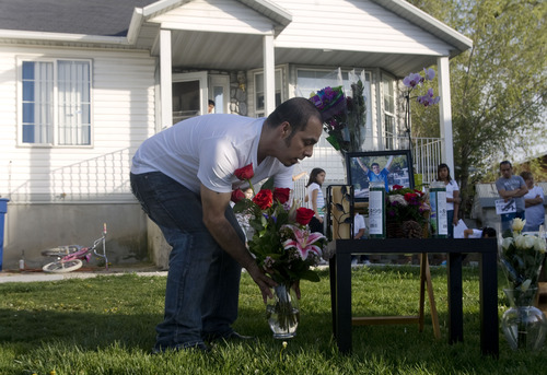 Kim Raff  |  The Salt Lake Tribune Friends and family place flowers and candles at a memorial Sunday for Ricardo Portillo, who died Saturday from injuries he sustained after a 17-year-old player allegedly hit him in the head during a game.