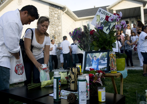 Kim Raff  |  The Salt Lake Tribune Alex Flores and Silvia Castro place candles at a memorial Sunday for Ricardo Portillo, a soccer referee who died Saturday from injuries he sustained after a 17-year-old player allegedly hit him in the head during a game.