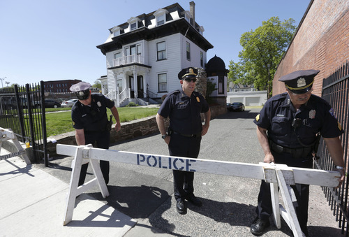 Law enforcement officials place a barricade at an entrance to the Graham, Putnam, and Mahoney Funeral Parlors, in Worcester, Mass., Sunday, May 5, 2013. Funeral director Peter Stefan has pleaded for government officials to use their influence to convince a cemetery to bury Tsarnaev, but so far no state or federal authorities have stepped forward. Men at left are unidentified. (AP Photo/Steven Senne)