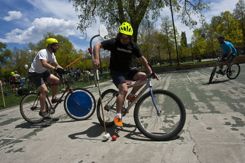 Chris Detrick     The Salt Lake Tribune A group plays bike polo during Salt Lake City's Open Streets Festival at Pioneer Park South Saturday May 4, 2013.