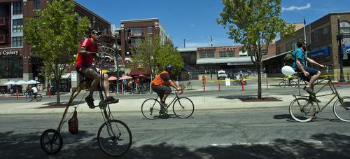 Chris Detrick     The Salt Lake Tribune Bikers ride along 300 South during Salt Lake City's Open Streets Festival South Saturday May 4, 2013.