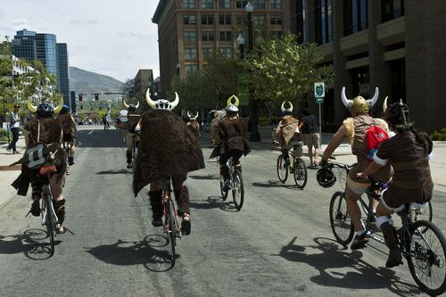 Chris Detrick     The Salt Lake Tribune A band of Vikings rides bikes along 300 South during the Tour de Brewtah Saturday May 4, 2013.