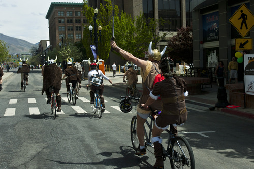 Chris Detrick  |  The Salt Lake Tribune A band of Vikings rides bikes along 300 South during the Tour de Brewtah Saturday May 4, 2013.