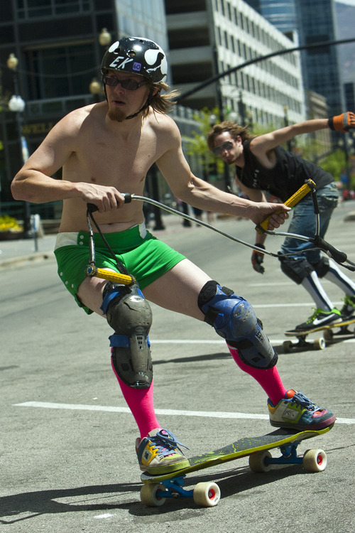 "Chris Detrick     The Salt Lake Tribune ""EK"" skates during Salt Lake City's Open Streets Festival along 300 South Saturday May 4, 2013."